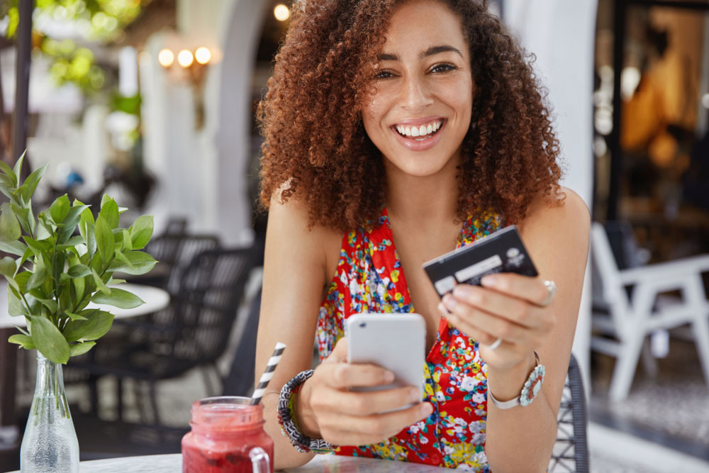 Smiling woman saving money on her cell phone bill