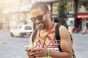 man unlocking his phone on the go